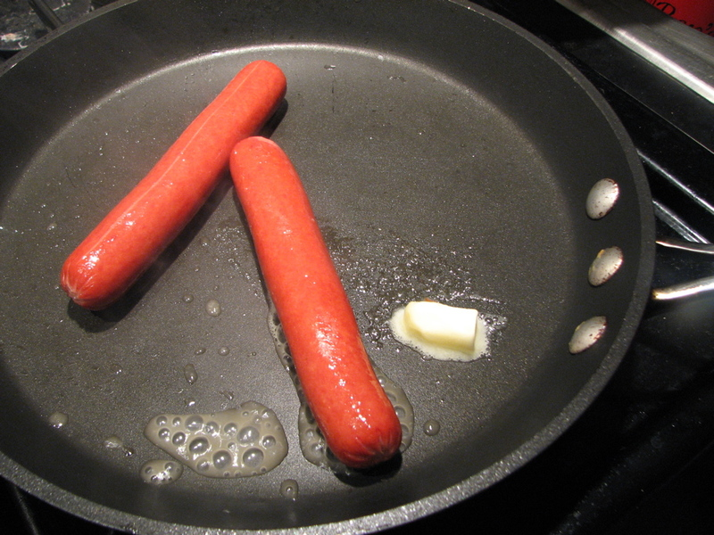 Little Hot Dogs Frying In A Pan