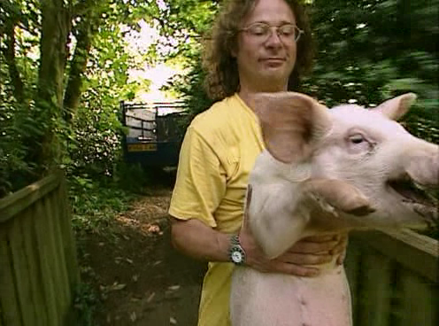 Hugh fearnel whittingstall with a pig